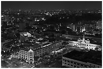 Peoples Committee building and Rex Hotel at night. Ho Chi Minh City, Vietnam ( black and white)