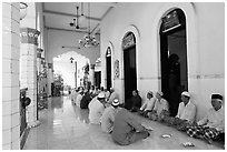 Men sharing food in gallery, Cholon Mosque. Cholon, District 5, Ho Chi Minh City, Vietnam (black and white)