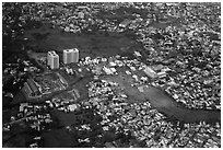Aerial view of houses and high-rises on the outskirts of the city. Ho Chi Minh City, Vietnam ( black and white)