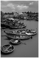 Fishing boats along river, Phan Thiet. Vietnam (black and white)