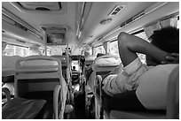 Inside bus with reclining seats for sleeping. Vietnam ( black and white)