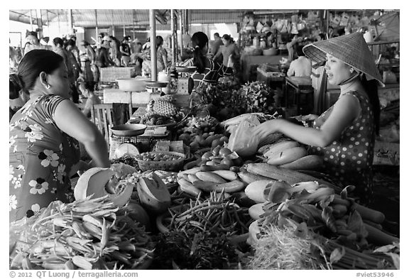 Buying and selling vegetable inside covered market, Cai Rang. Can Tho, Vietnam