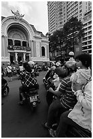 Family on motorbike watching performance at opera house. Ho Chi Minh City, Vietnam ( black and white)