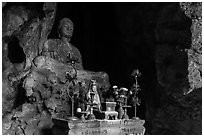 Altar and Buddha statue in cave. Da Nang, Vietnam (black and white)