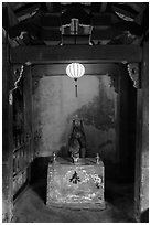 Monkey altar lit by lantern, Japanese Bridge. Hoi An, Vietnam (black and white)
