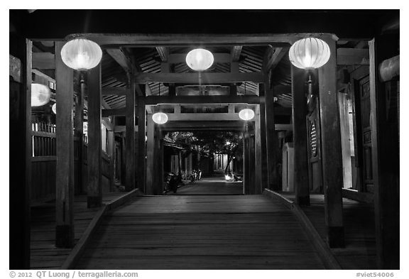 View through the inside of Covered Japanese Bridge at night. Hoi An, Vietnam