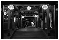 View through the inside of Covered Japanese Bridge at night. Hoi An, Vietnam (black and white)