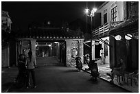 Night street scene near the Japanese Bridge. Hoi An, Vietnam (black and white)