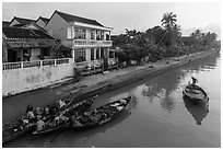 Waterfront with people selling from boats. Hoi An, Vietnam (black and white)