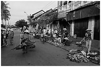Fruit and vegetable vendors in old town. Hoi An, Vietnam ( black and white)