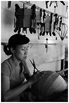 Woman working on paper lantern. Hoi An, Vietnam ( black and white)