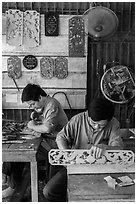 Wood carving workshop. Hoi An, Vietnam ( black and white)