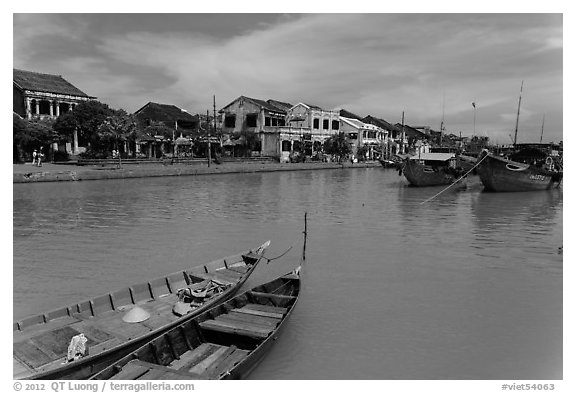 Boats, Thu Bon River, and houses. Hoi An, Vietnam (black and white)