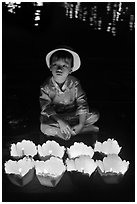 Boy with candle lanterns for sale. Hoi An, Vietnam (black and white)