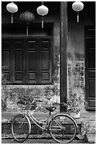 Bicycle and facade with lanterns. Hoi An, Vietnam (black and white)