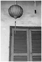 Paper lantern, wall, and blue shutters. Hoi An, Vietnam (black and white)