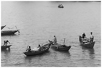 Fishermen on small boats. Vietnam ( black and white)
