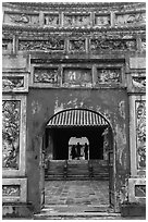 Palace and silhouettes seen from doorway, citadel. Hue, Vietnam ( black and white)