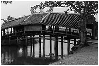 Friends sitting inside covered bridge, Thanh Toan. Hue, Vietnam (black and white)