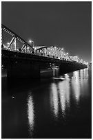 Trang Tien Bridge lights reflected in Perfume River. Hue, Vietnam (black and white)