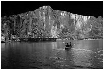 Kayaking out of Luon Cave. Halong Bay, Vietnam (black and white)