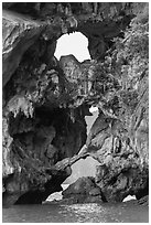 Openings through rocks. Halong Bay, Vietnam (black and white)