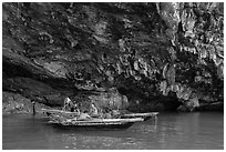 Fishermen anchor in cave for breakfast. Halong Bay, Vietnam (black and white)