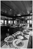 Pho buffet in tour boat dining room. Halong Bay, Vietnam (black and white)