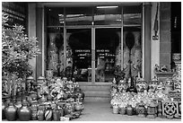 Ceramic store front with vases of all sizes. Bat Trang, Vietnam ( black and white)