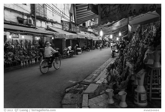 Street with flower sellers in early morning, old quarter. Hanoi, Vietnam