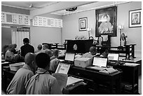 Monks working on computers, An Quang Pagoda, district 10. Ho Chi Minh City, Vietnam (black and white)