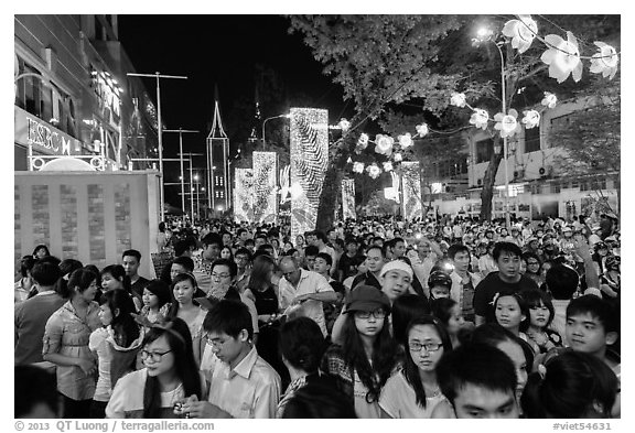 Street filled with crowds on Christmas eve. Ho Chi Minh City, Vietnam