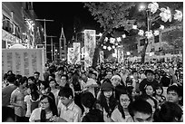 Street filled with crowds on Christmas eve. Ho Chi Minh City, Vietnam ( black and white)