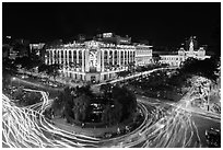 Traffic circle with light trails, Rex Hotel and City Hall. Ho Chi Minh City, Vietnam ( black and white)