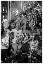 Young Revellers in front of Notre Dame Cathedral on Christmas Eve. Ho Chi Minh City, Vietnam ( black and white)