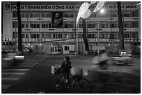 Vendor with bicycle at night. Ho Chi Minh City, Vietnam (black and white)