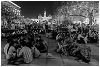 Groups in front of City Hall on New Year eve. Ho Chi Minh City, Vietnam ( black and white)