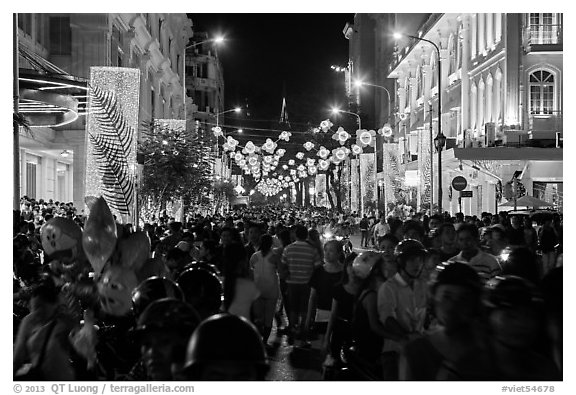 Packed street at night, New Year eve. Ho Chi Minh City, Vietnam