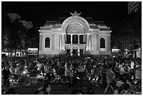 Crowds in front of Opera House at night. Ho Chi Minh City, Vietnam ( black and white)