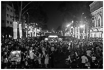 Le Loi boulevard crowds on New Year eve. Ho Chi Minh City, Vietnam ( black and white)