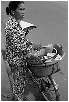 Woman vending food out of bicycle. Tra Vinh, Vietnam (black and white)