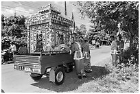 Funeral vehicle and attendants. Tra Vinh, Vietnam (black and white)