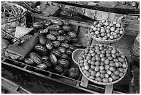 Vegetables and fruit for sale on boat, Phung Diem. Can Tho, Vietnam (black and white)