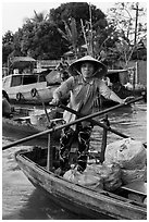 Woman using the x-shape paddles. Can Tho, Vietnam (black and white)