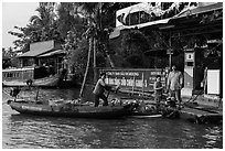 Women refilling boat tank. Can Tho, Vietnam (black and white)