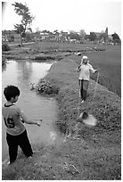 Field irrigation with a swinging bucket. Vietnam (black and white)
