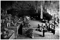 Group praying at the altar at the entrance of Tan Thanh Cave. Lang Son, Northest Vietnam (black and white)