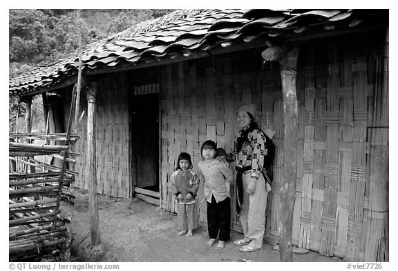 Family outside their home. Northeast Vietnam