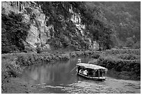 Shallow boats transport villagers to a market. Northeast Vietnam (black and white)