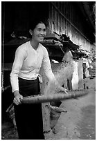 Woman of the Thai ethnicity sorting grain, near Mai Chau. Vietnam (black and white)
